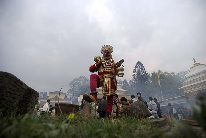 A sadhu dressed as Hanuman, the monkey god of the Hindu pantheon, poses on the eve of the Hindu festival Maha Shivaratri in Kathmandu.?Photo by AFP