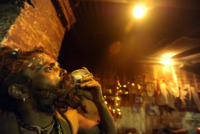 A sadhu blows a conch shellon the eve of the Hindu festival Maha Shivaratri in Kathmandu.?Photo by AFP