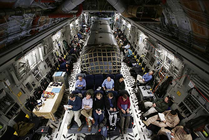 "The ""Silver Bullet"" airstream trailer (C) carrying US Secretary of Defense Chuck Hagel is pictured inside a US Air Force C-17 aircraft transporting him and his staff from Kabul to Ramstein Airbase in Germany.  US Defense Secretary Chuck Hagel's first trip to Afghanistan was overshadowed on March 10 by a contentious speech by Afghan President Hamid Karzai and a security scare that forced their press conference to be cancelled."