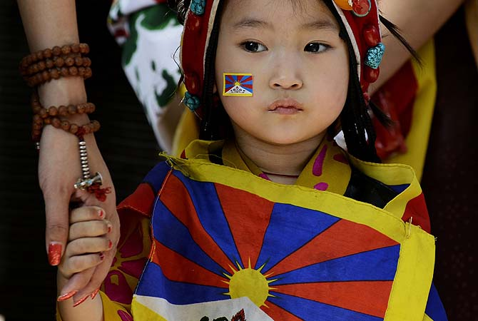 A young Tibetan exile residing in India looks on during a protest rally in New Delhi. The protest marked the 54th anniversary of the Tibetan national uprising, the 1959 rebellion against China's rule in Tibet.