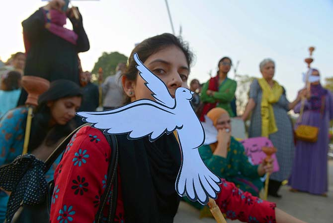 Pakistani human rights activists gather to mark International Women's Day in Islamabad on March 8, 2013. ?Photo by AFP