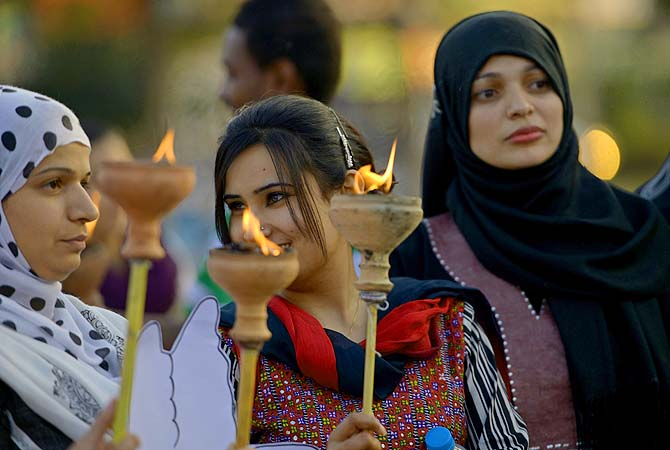 Pakistani human rights activists hold lamps during a rally to mark International Women's Day in Islamabad on March 8, 2013. The activists demonstrated to mark International Women's Day in a culture that often treats women as second-class citizens.?Photo by AFP