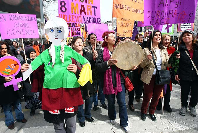 "Women hold placards reading ""We will stop AKP (Turkey's Justice and Development ruling Party)"" as they march to commemorate the International Women's Day on March 8, 2013 in Ankara. Hundreds of demonstrators took part in the rally calling to stop violence towards women. ?Photo by AFP"