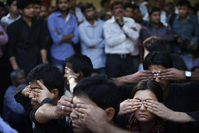 Young Indian men and women reflect the attitude of the society of closing their eyes to sexual abuse against women as they stage a street play against sexual abuse of women and ways to raise voice against it on International Women's Day, in New Delhi, India, Friday, March 8, 2013.?Photo by AP