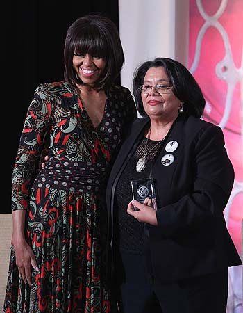 "Honduras Truth and Reconciliation Commission member Julieta Castellanos (R) poses for photographs with US first lady Michelle Obama after receiving the International Women of Courage award at the State Department March 8, 2013 in Washington, DC. In celebration of the 102nd International Women's Day, the State Department honored nine women from around the world with the International Women of Courage Award, including the 23-year-old Indian woman known only as ""Nirbhaya,"" who died from injuries she received after bei"