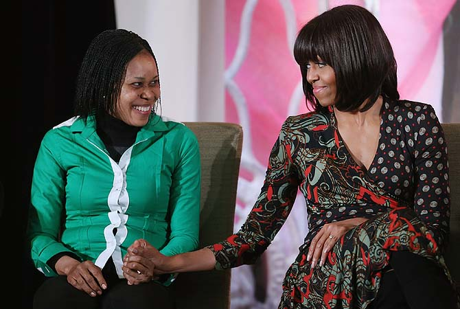 "US first lady Michelle Obama (R) holds hands with women's rights advocate Dr. Josephine Obiajulu Odumakin of Nigeria after she received the International Women of Courage award at the State Department March 8, 2013 in Washington, DC. In celebration of the 102nd International Women's Day, the State Department honored nine women from around the world with the International Women of Courage Award, including the 23-year-old Indian woman known only as ""Nirbhaya,"" who died from injuries she received after being gang rape"