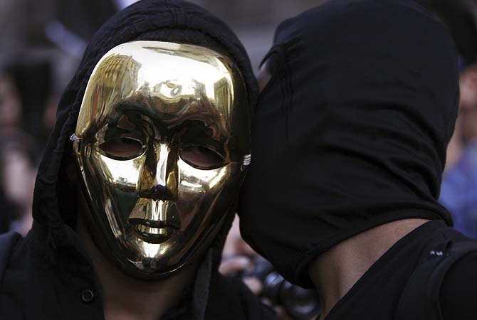 Members of the anti-Mursi Black Bloc Egypt group take part in a protest rally against Egyptian President Mohamed Mursi and members of the Muslim Brotherhood in front of the courthouse and the Attorney General's office, near Tahrir Square in Cairo March 8, 2013. The rally was organized by women and falls on International Women's Day.?Photo by Reuters