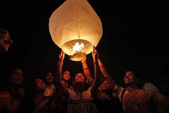 Activists of All India Peace and Solidarity Organization (AIPSO) release a sky lantern on International Women's Day in Hyderabad, India, Friday, March 8, 2013.?Photo by AP