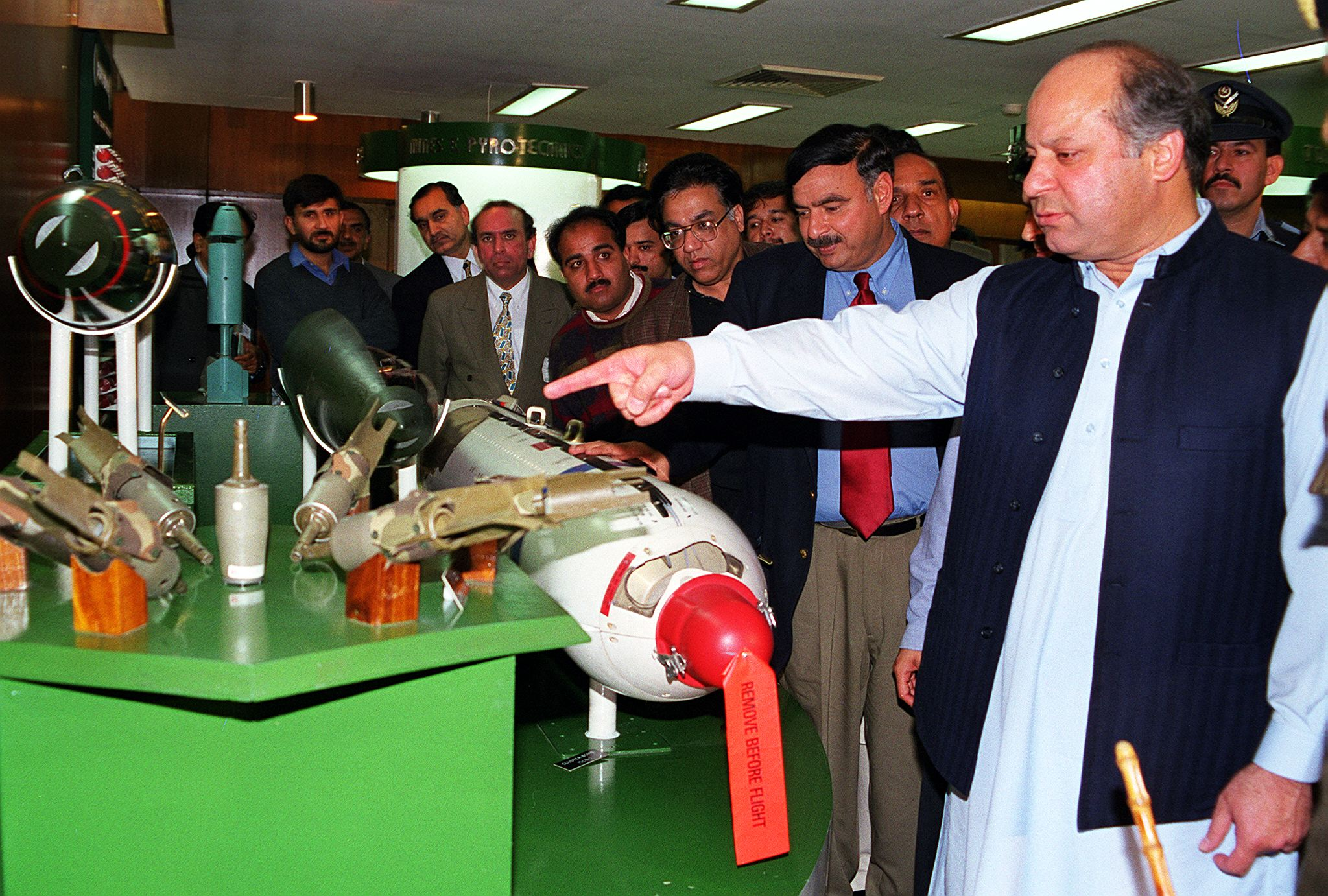 Prime Minister Nawaz Sharif (R) inspects medium range missiles and other weapons manufactured in Wah Ordnance Factory, some 40 kilometres from Islamabad, 25 February. Sharif said Pakistan's defence had been made impregnable through acquisition of nuclear capability. He said no enemy could dare attack Pakistan as every one was aware that it was a nuclear power now. — Photo by AFP/File