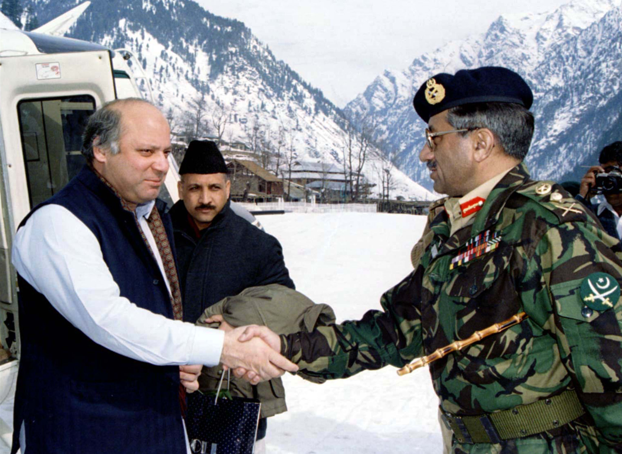 Prime Minister Nawaz Sharif  is greeted by army chief General Pervez Musharraf on arrival at the snow-clad town of Kail on the border in the disputed Himalayan region of Kashmir in this February 5, 1999 file photo. — Reuters
