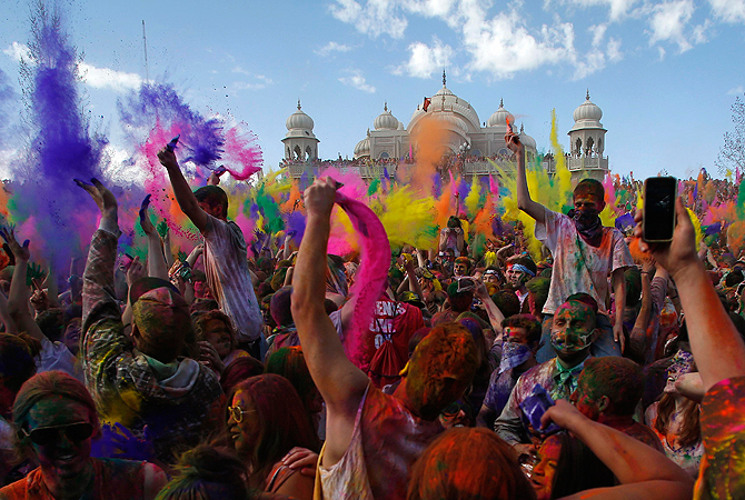 Participants dance and throw colored chalk during the Holi Festival of Colors at the Sri Sri Radha Krishna Temple in Spanish Fork, Utah. According to organizers 50,000 people were expected pack the temple grounds to celebrate Holi, the passing of winter to spring, and throw colorful powder throughout the day.