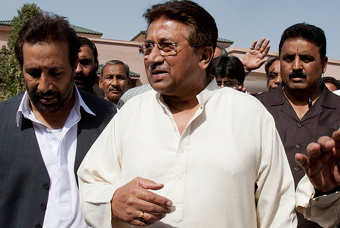 In this Monday, April 15, 2013 photo, Pakistan's former President and military ruler Pervez Musharraf arrives under tight security to address his party supporters at his house in Islamabad, Pakistan.