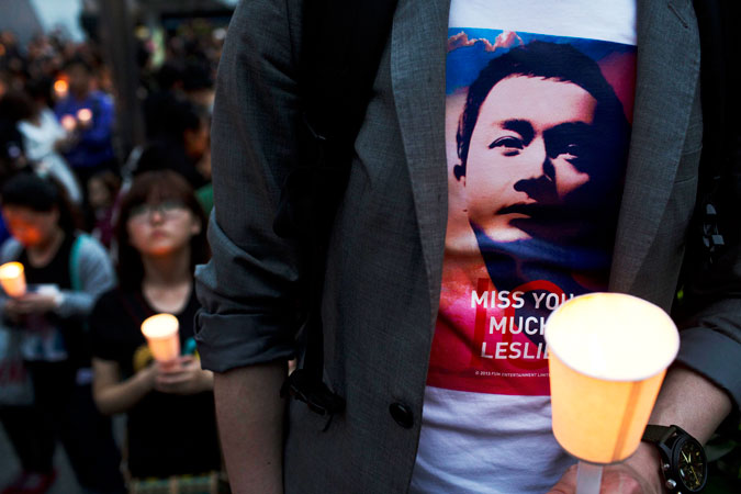 A fan wearing a T-shirt with a portrait of the late Hong Kong canto-pop star Leslie Cheung attends a candlelight vigil in Hong Kong.
