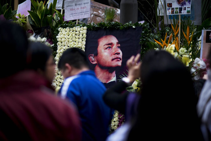 A photograph of the late Leslie Cheung Kwok-wing is displayed next to the Mandarin Oriental Hotel, during a remembrance on the 10th anniversary of his death.