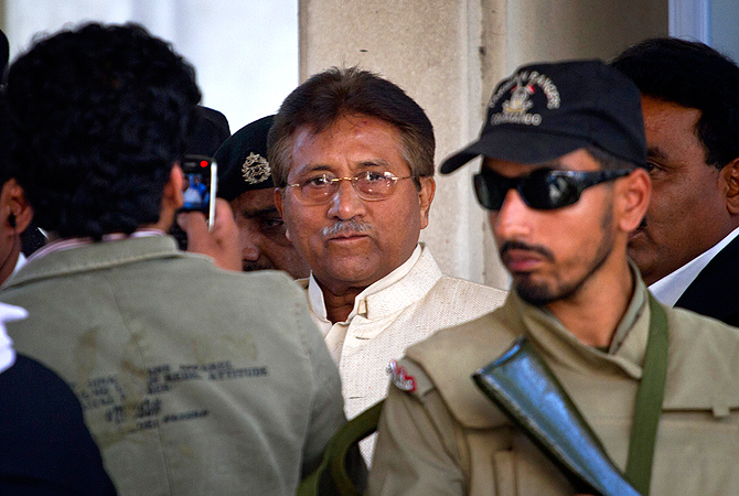 Pakistan's former president and military ruler Pervez Musharraf, center, leaves after appearing in court in Rawalpindi, Pakistan on Wednesday, April 17, 2013.
