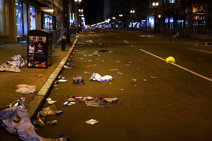 Debris and litter cover an empty street near the scene of a twin bombing at the Boston Marathon.