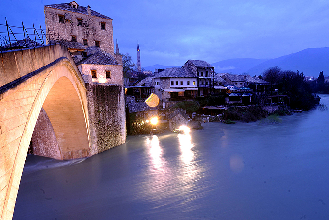 "The ""Old Bridge"" in the historical core of the Southern-Bosnian town of Mostar is seen after the level of the Neretva river has rose approximately 3 meters compared to it's normal summertime levels, on April 3, 2013. Water levels have dramatically risen countrywide due to snow-melt and large quantities of rain in the past seven days."