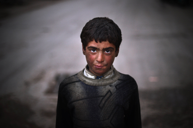 A Syrian boy who works as a car mechanic poses for a picture in the northern city of Azaz on April 10, 2013. The United States is mulling ways to step up support for the Syrian opposition, a top US official said, as US Secretary of State John Kerry and G8 ministers were to meet rebel leaders.