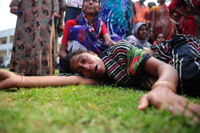 A Bangladeshi woman reacts after identifying the body of her husband killed in the collapse. —Photo by AFP