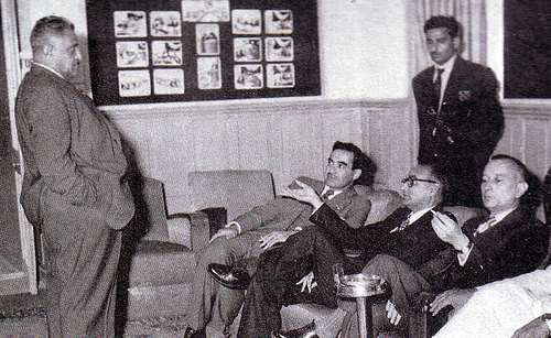 Parliamentarians take a smoke break after passing the 1956 Constitution.