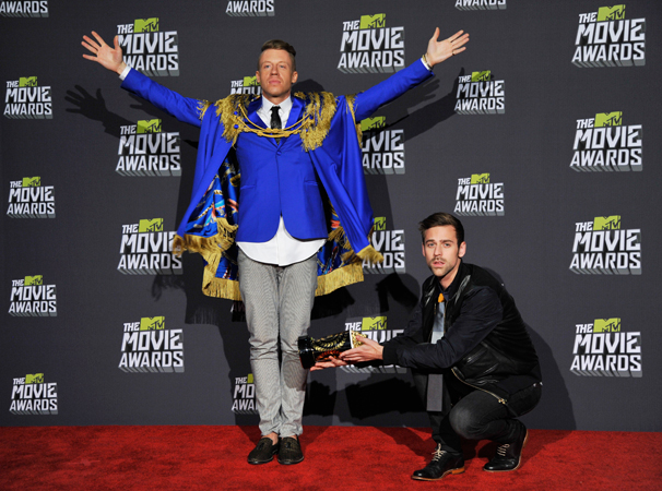 Macklemore, left, and Ryan Lewis pose backstage with an award.