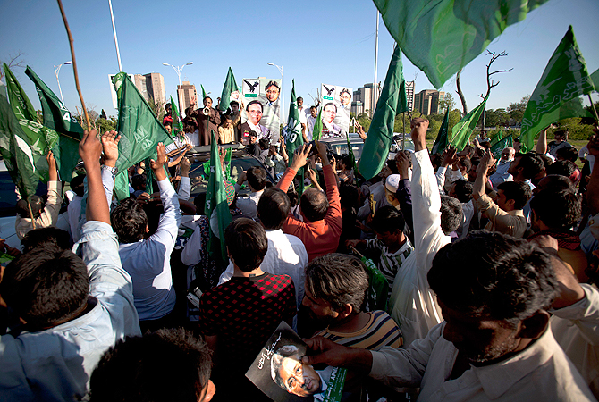 Supporters of Pakistan's former President and military ruler Pervez Musharraf rally to condemn court cases against their leader in Islamabad, Pakistan on Wednesday, April 17, 2013.