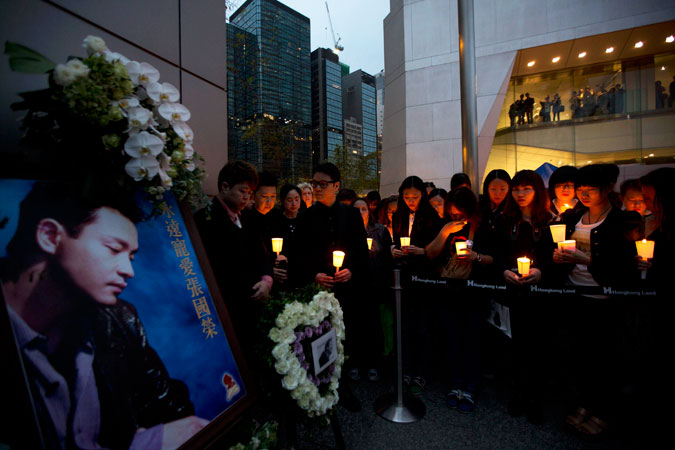 Fans of the late Hong Kong canto-pop star Leslie Cheung attend a candlelight vigil.