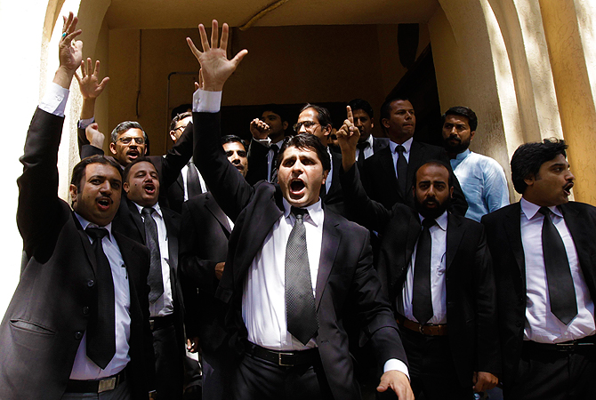 Lawyers chant slogans against Pakistan's former President Pervez Musharraf as he appears before the High Court in Rawalpindi April 17, 2013.