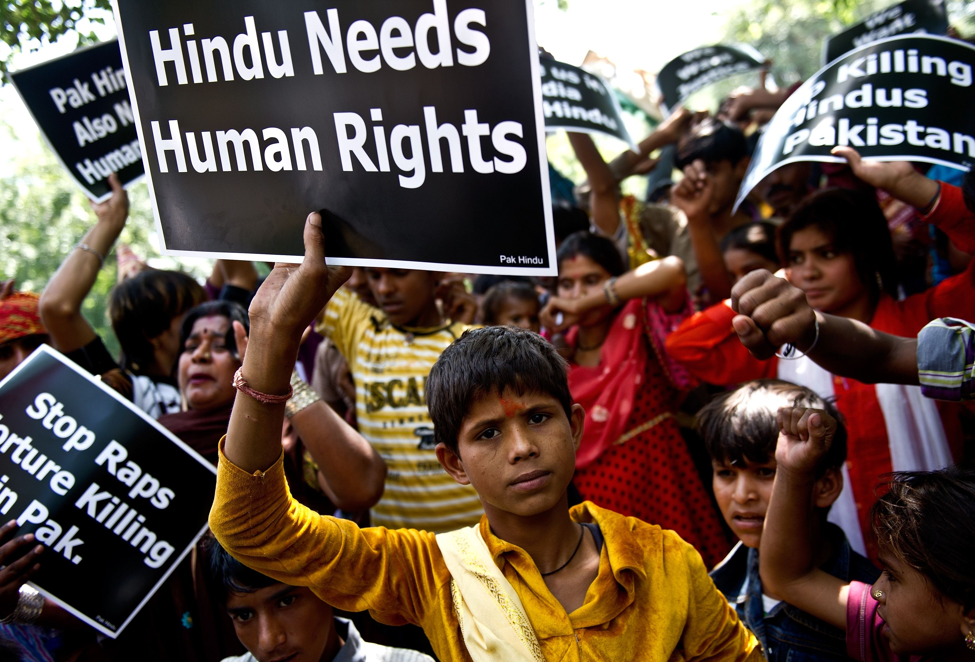 A minority Hindu refugee from Pakistan gestures with a placard during a protest outside the United Nations office in New Delhi.