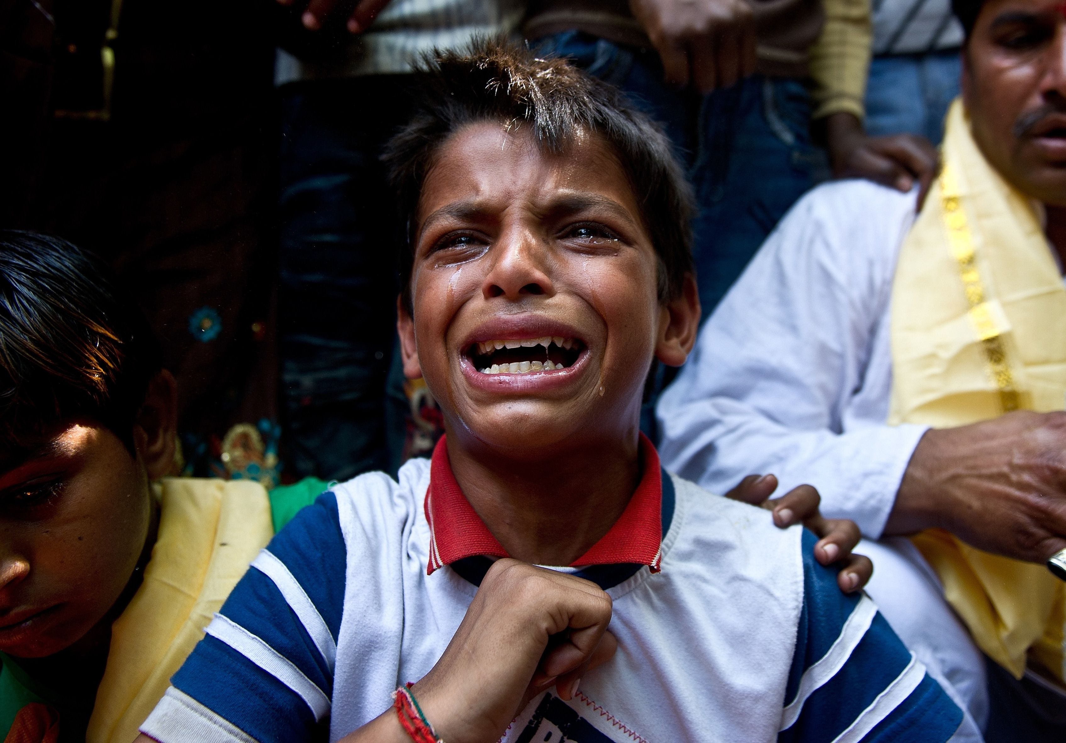 A young minority Hindu refugee from Pakistan breaks down during a protest outside the United Nations office in New Delhi on April 17, 2013.