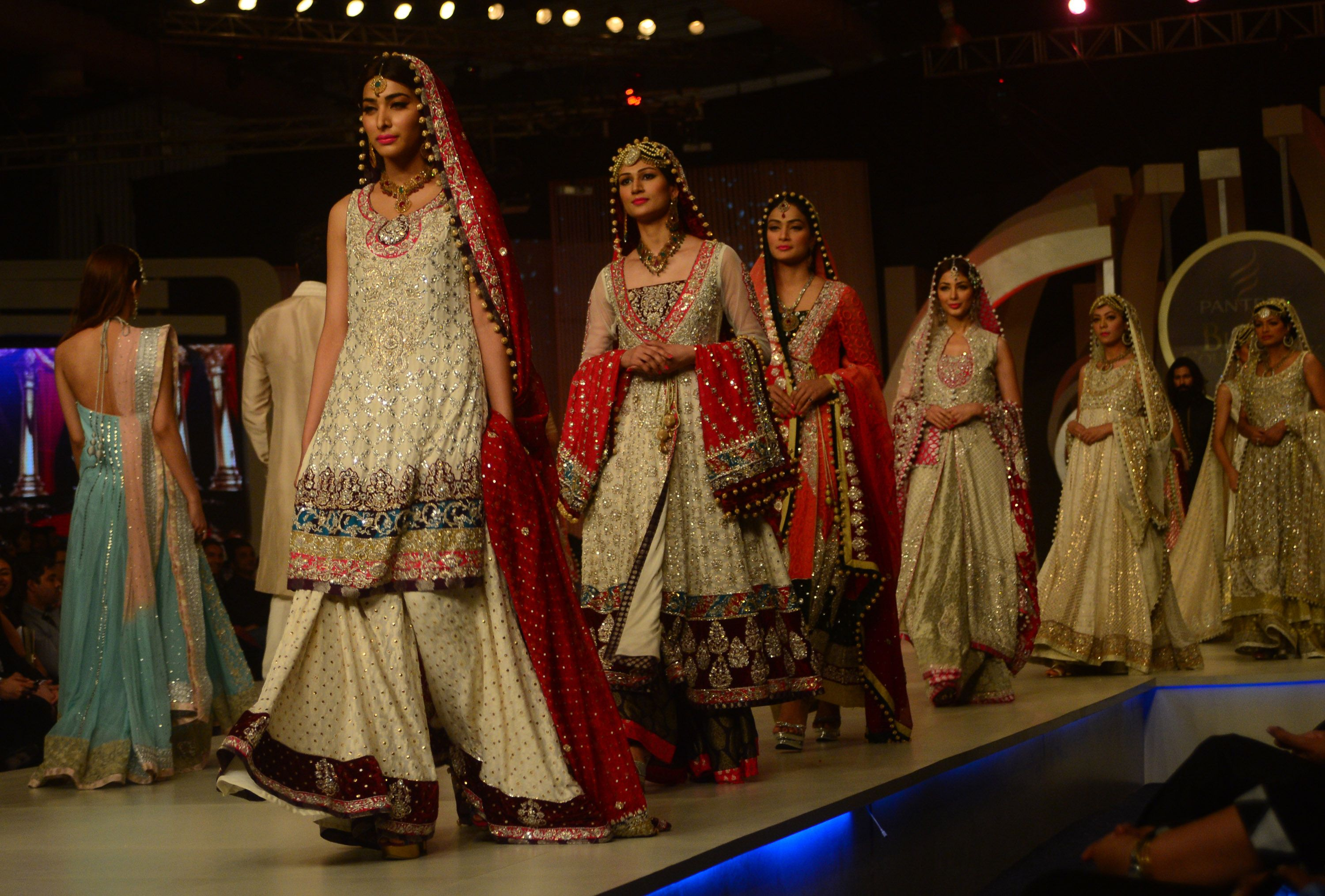 Pakistani models present creations by designer Zainab Chotani. — AFP Photo