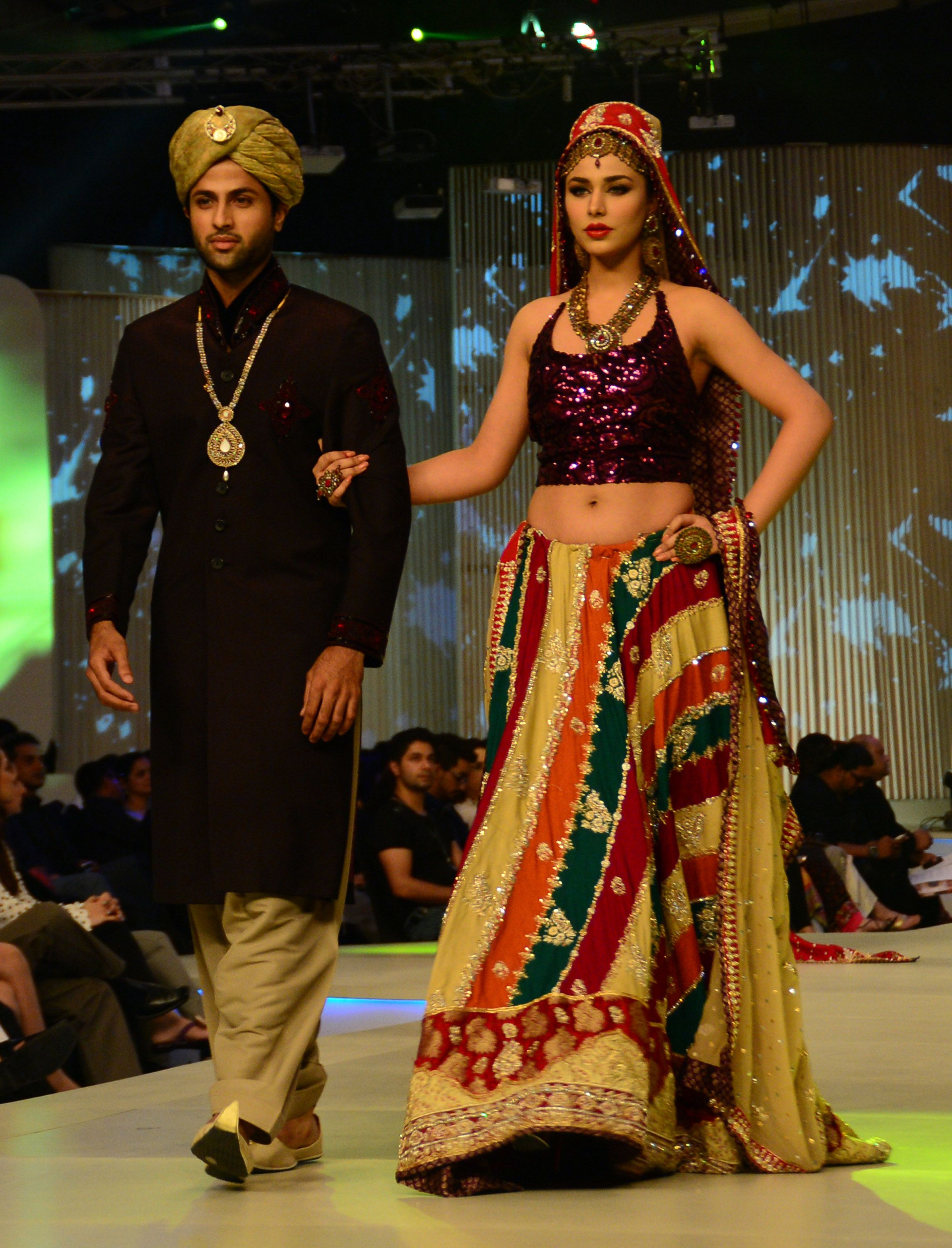 Models present creations by Pakistani designer Mona Imran. — AFP Photo