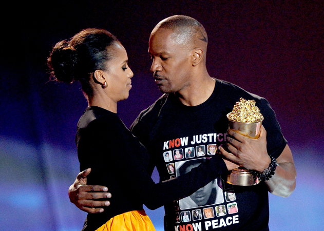 Actor Jamie Foxx accepts the MTV Generation Award from actress Kerry Washington onstage.