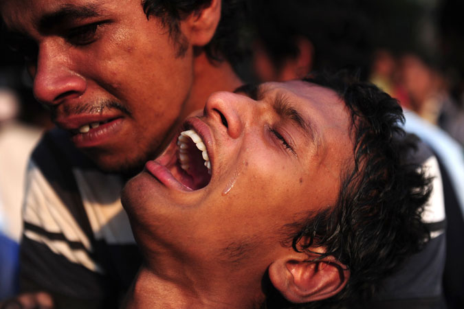 A Bangladeshi youth reacts after seeing his relative's dead. —Photo by AFP