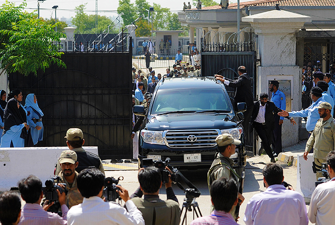 Pakistan's former President and military ruler Pervez Musharraf leaves the High Court in Islamabad, Pakistan, Thursday, April 18, 2013.