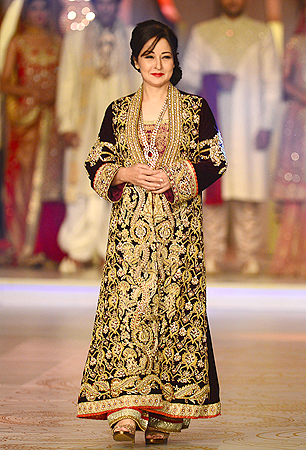Pakistani film and television actress Zeba Bakhtar presents a creation by designer Mifrah. — AFP Photo