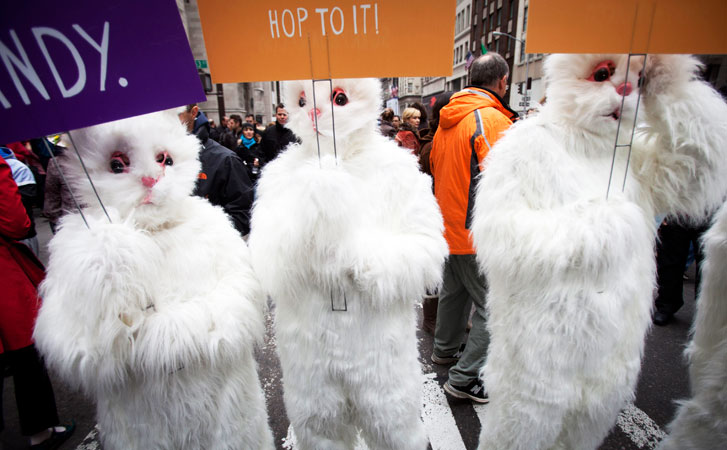People dressed up as Easter bunnies take part in a guerrilla marketing campaign during the parade.