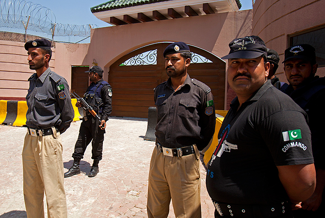 Pakistan police officers stand alert outside the house of Pakistan's former President and military ruler Pervez Musharraf in Islamabad, Pakistan, Thursday, April 18, 2013.