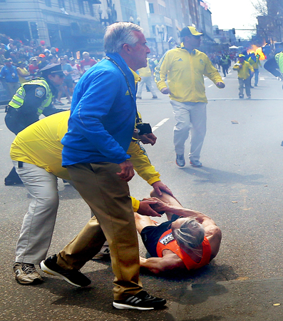 People react to a second explosion at the 2013 Boston Marathon.