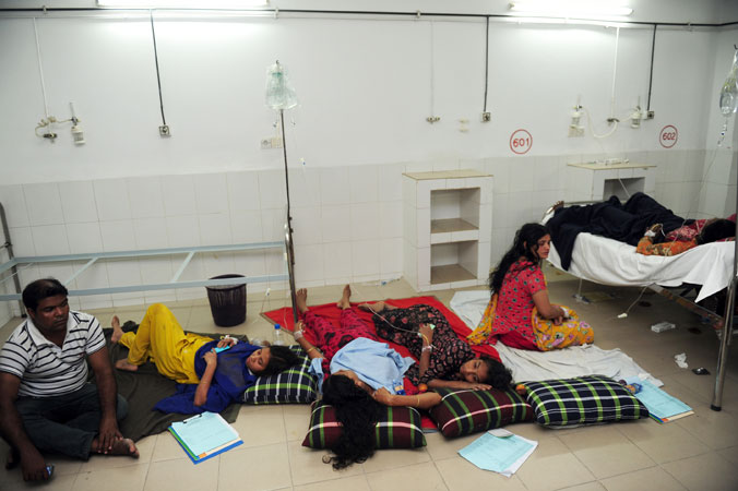 Bangladeshi victims rescued from the rubble are treated in a hospital. —Photo by AFP