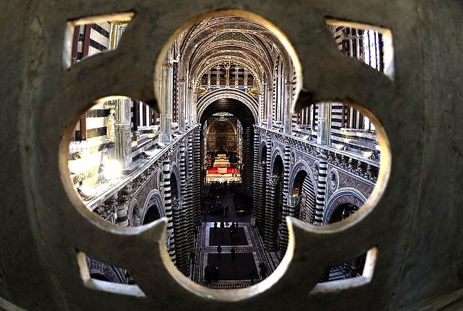 "Visitors walk in the cathedral of Siena during the presentation of ""The Gate of Heaven"" tour on April 5, 2013. Following lengthy restoration, visitors will be able to admire from April 6 to October 27, the"