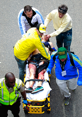 Medical workers aid an injured man at the finish line.