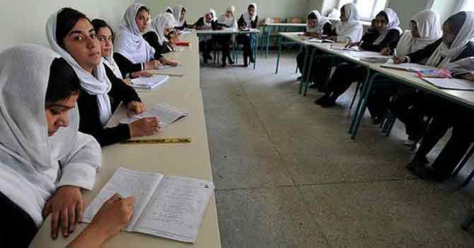 School girls studying in a classroom -Photo by AFP