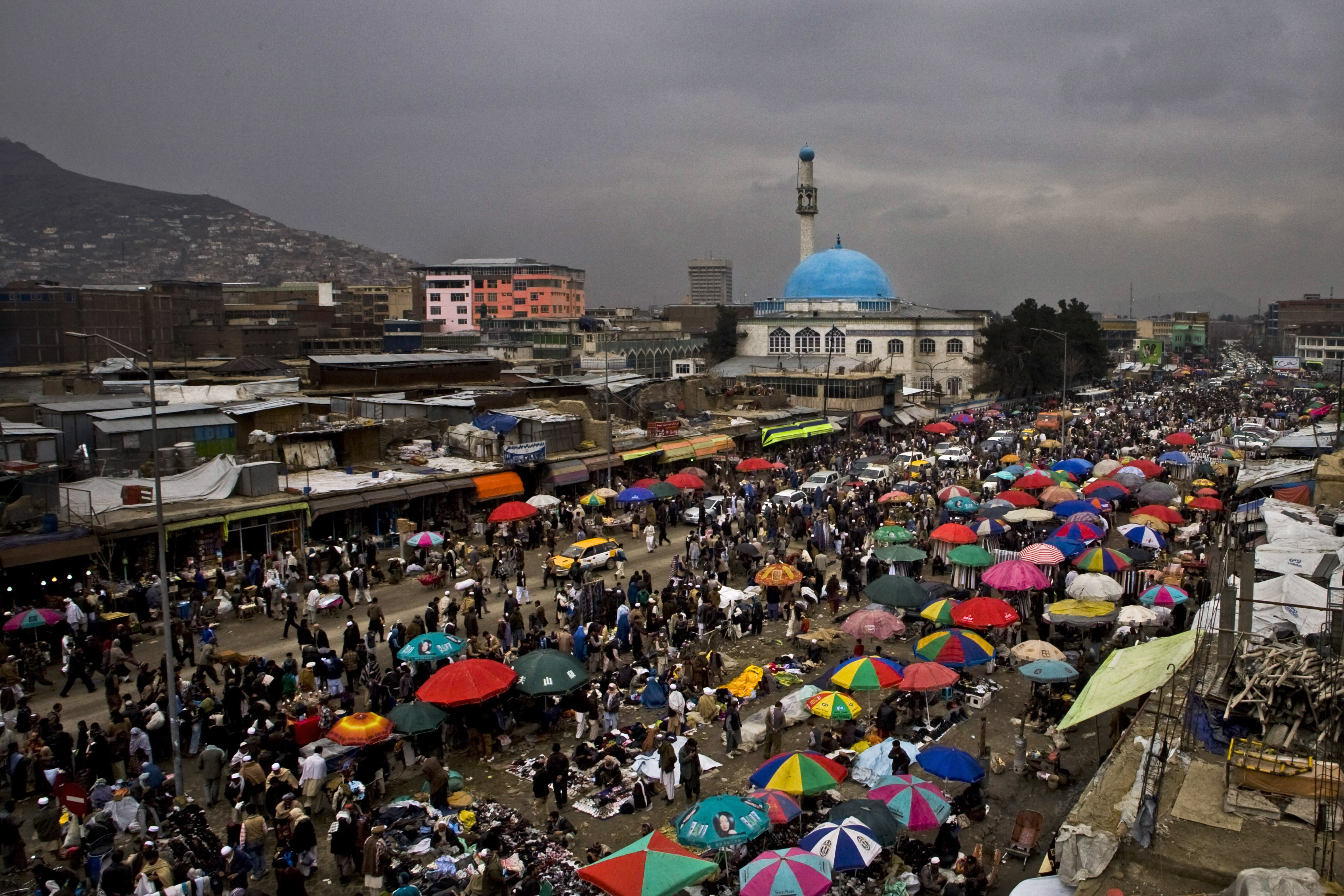 Afghans shop at an open air market a day before the celebration of the Persian New Year Nowruz in Kabul, Afghanistan. Nowruz marks the first day of spring and the beginning of the year on the Iranian calendar.