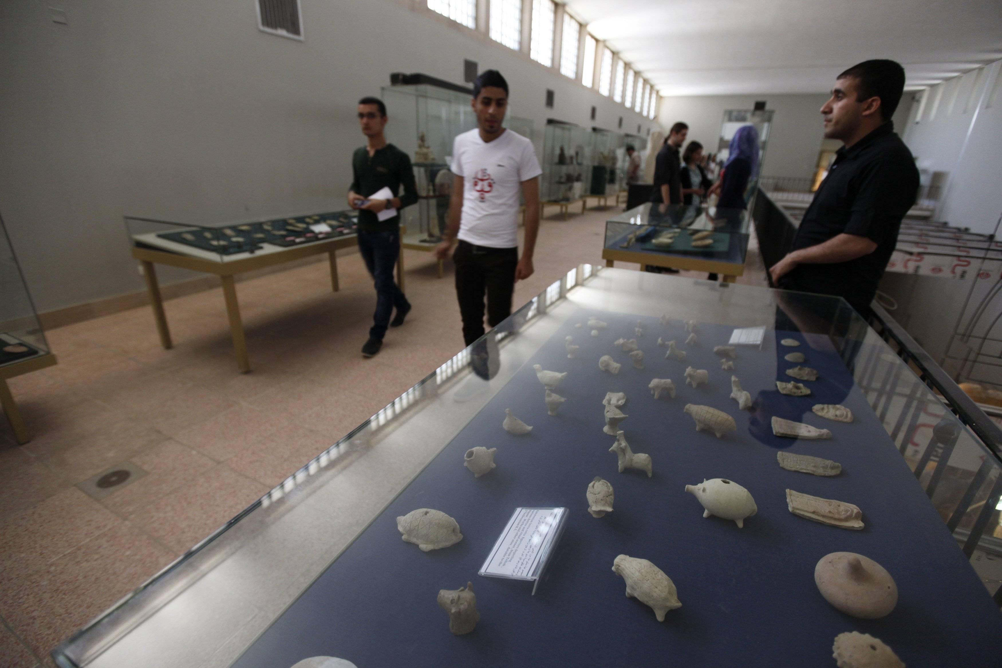 People look at artifacts at the National Museum of Iraq in Baghdad.