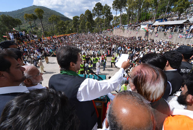 Imran Khan (C) addresses supporters.
