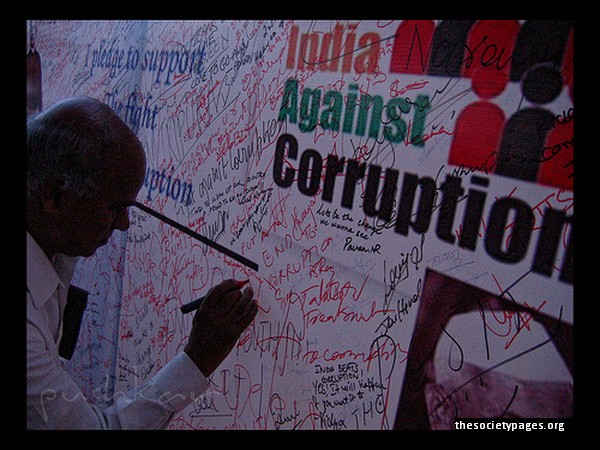 A man scribbles his comments on a writing board placed at an Anna Hazare rally in India. Hazare, a veteran Indian politician, became the darling of urban middle-class India and was also courted by right-wing parties throughout his campaign against the 'corrupt Congress government.'