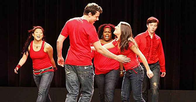 "Cory Monteith and girlfriend Lea Michele (front two) in a scene from ""Glee"". —Photo (File) AP"
