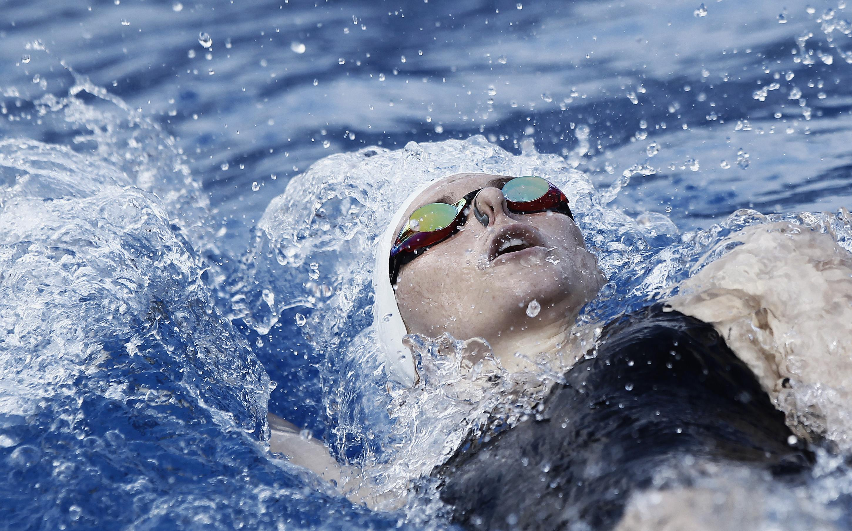Guatemala's Gisela Morales swims to win the gold medal during the women's 200 meters backstroke final in the Central American Games in San Jose.
