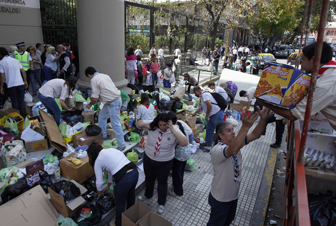 Volunteers organize donations for flood victims and load them onto a truck outside Buenos Aires Cathedral. At least 51 people were killed in Argentina on Wednesday after a torrential downpour battered the eastern city of La Plata and forced some 1,000 people to flee their homes in search of dry ground, authorities said on Thursday.
